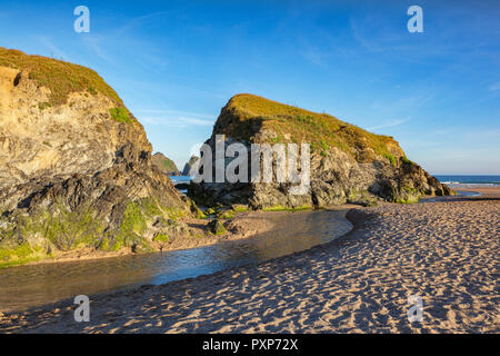 Rocks on Holywell Beach, with a view through  to Carters Rocks, Cornwall, UK - Stock Image