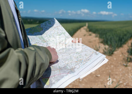 Close up of map reading while rambling through the countryside - Stock Image