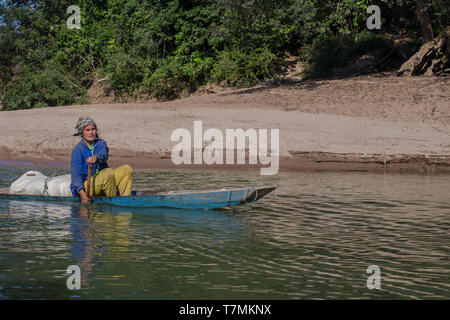 A woman paddling in the water of the Nam Ou River, Laos - Stock Image