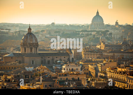 Eternal city of Rome rooftops and towers golden sunset view, capital of Italy - Stock Image