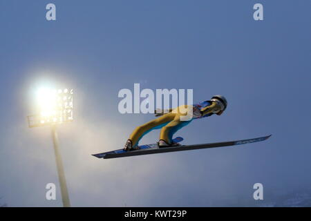 Bischofshofen, Austria. 05th, Jan 2018. Huber Daniel from Austria soars through the air during the qualification - Stock Image