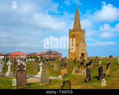The tower and spire of St Germain's church Marske by the Sea a Grade 2 listed building built in 1160 the rest demolished 1950 in the churh yard - Stock Image
