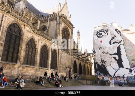 Saint Merry church and the autoportrait of the French artist Jef Aerosol overlooking Place Igor Stravinsky in Paris, France. - Stock Image