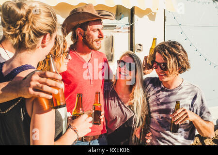 Group of people young men and women have fun withfriendship all together under the sunny vacation day in outdoor - cheerful caucasian girls and boys d - Stock Image