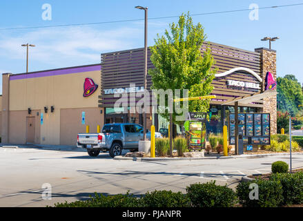 HICKORY, NC, USA-9/2/18: A Taco Bell restaurant in Hickory, NC, showing the drive-thru, and one pickup truck parked in lot. No people are visible. - Stock Image