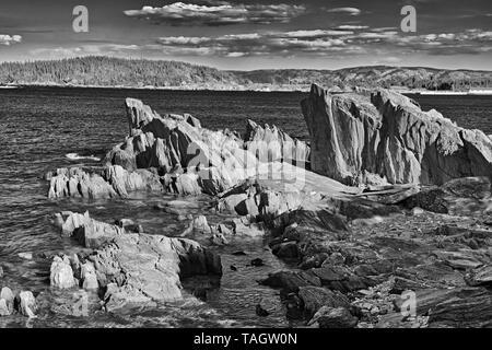 Rocky shoreline along the Atlantic Ocean. Baie Verte Peninsula. Coachman's Cove Newfoundland & Labrador Canada - Stock Image