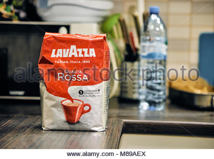 Lavazza Qualita Rosso coffee beans bag standing on a wooden table - Stock Image