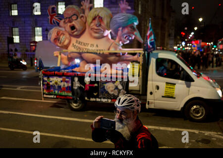 Cyclists and a political parody in Westminster before the result of MPs' Meaningfull Brexit vote which eventually brought about a massive defeat for Prime Minister Theresa May's Conservative government, on 15th January 2019, in Westminster, London, England. - Stock Image