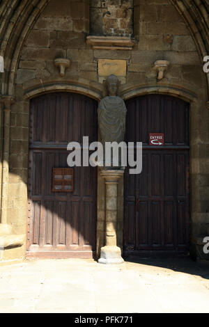 Doorway and sculpture on Cathedrale Saint Pol d'Aurelien in Place Alexis Gourvennec, St Pol de Leon, Finisterre, Brittany, France - Stock Image