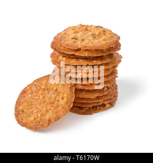 Stack of traditional Kletskop cookies, a crispy thin baked cookie, originally made in Brugge, Belgium isolated on white background - Stock Image