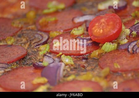 Homemade mixed topping pizza closeup - Stock Image