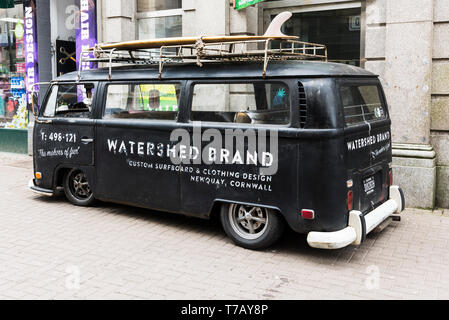 A vintage rat look Volkswagen campervan advertising Watershed Brand parked in Newquay Town Centre in Cornwall. - Stock Image