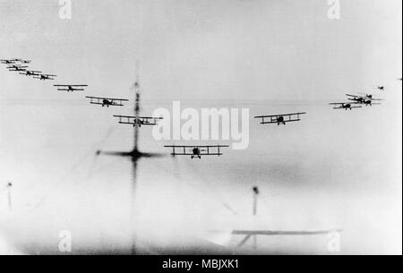 Buying Biplanes in Formation - Stock Image