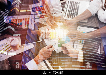 Business people join puzzle pieces in office. Concept of teamwork and partnership. double exposure with light effects - Stock Image