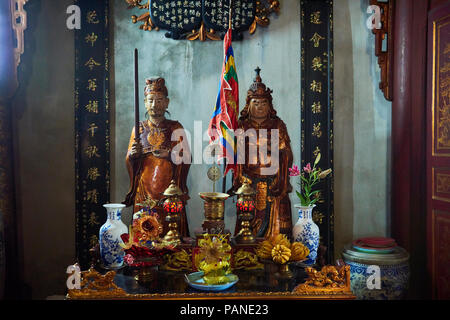 Two statues of Taoist deities inside Quan Thanh Temple in Hanoi, Vietnam. - Stock Image