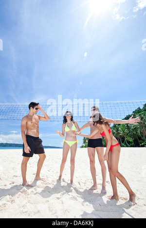 Friends playing beach volleyball. - Stock Image