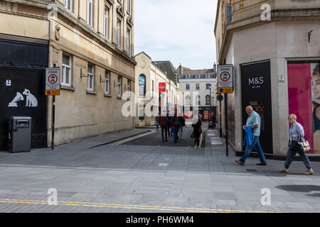 A view of people walking down Abbeygate Street in the City of Bath - Stock Image
