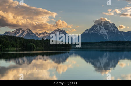 Tetons Reflect in Jackson Lake in Late Afternoon Light - Stock Image