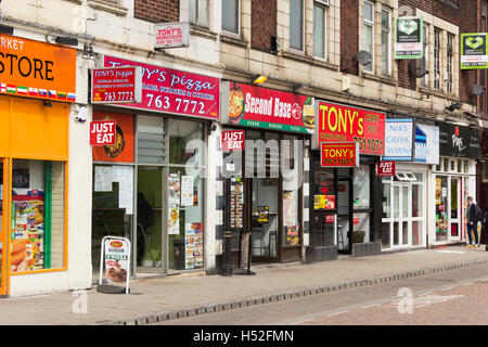 Row of town centre takeaway fast food outlets on Haymarket Street, Bury, some are part of the 'Just Eat' - Stock Image