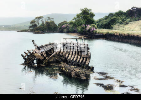 an old ship wreck in the sea - Stock Image