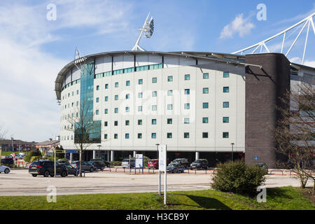 The Bolton  Whites hotel which forms part of the western end of Bolton Wanderers' home ground, the Macron Stadium. - Stock Image