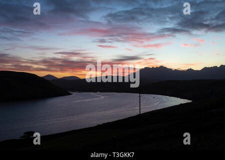 Dawn over Loch Harport and the Cuillin Hills on Isle of Skye, Highland Region, Scotland, UK - Stock Image