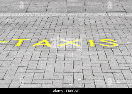 Taxi parking marked on a street in the UK - Stock Image
