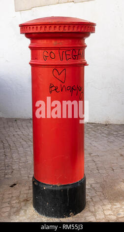 Traditional British Style Red Postpillar box,  Box Mailbox With Graffiti Go Vegan Be Happy Written On It In Lagos Old Town Portugal - Stock Image