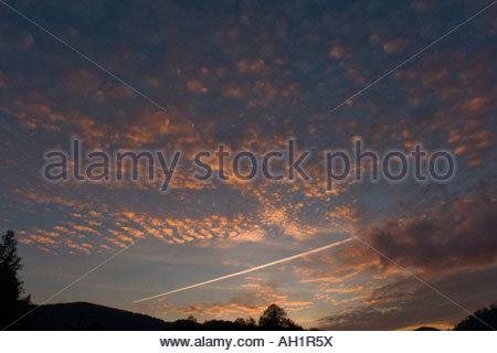 Glorious evening sky with clouds and jet aircraft trail - Stock Image