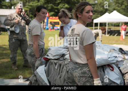 Members of Detachment 1, 102nd Medical Group, Otis Air National Guard Base, Mass. prepare for a demonstration. Family and friends of the 102nd MG were invited to participate as patients in the mock exercise, which aims to showcase what Airmen do in a disaster response. - Stock Image