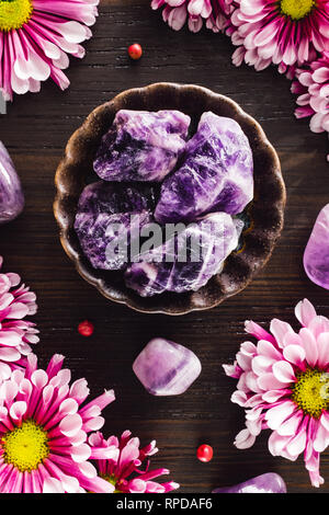 Amethyst and Pink Mums on Dark Wood - Stock Image