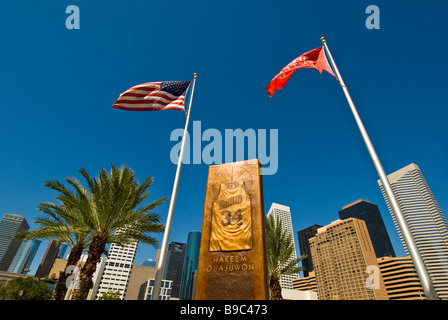 Hakeem Olajuwon Houston Texas astros NBA basketball player bronze monument two american flags  city landmark at - Stock Image