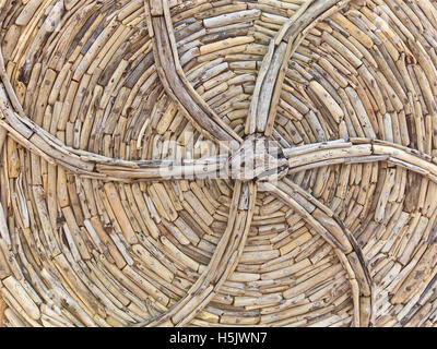 Wooden drift wood design chair, background - Stock Image