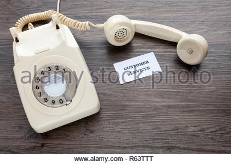 Retro telephone with note - Customer Services - Stock Image
