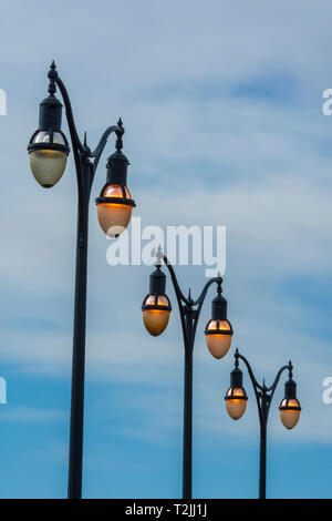 A row of parking lot lights in the early morning, Castle Rock Colorado US. Photo was taken in April. - Stock Image