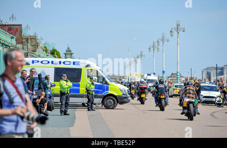 Brighton UK 1st June 2019 - Hundreds of Hells Angels arrive along Brighton seafront as part of their 50th anniversary celebration weekend . Over 3000 bikers from  rround the world have gathered in Surrey before heading down towards Brighton today where a heavy police presence was keeping an eye on them . Credit : Simon Dack / Alamy Live News - Stock Image