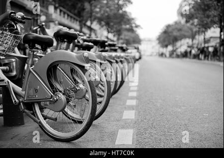 Bicycles on street in Paris - Stock Image