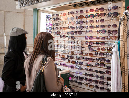 Two women window shopping for designer sunglasses - USA - Stock Image