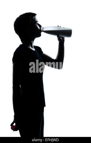one caucasian young teenager silhouette boy or girl drinking milk  portrait in studio cut out isolated on white - Stock Image