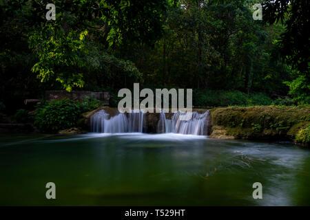 Beautiful waterfall in Thailand, Namtok Chet Sao Noi Park, Saraburi, featuring lush green tropical vegetation, long exposure - Stock Image