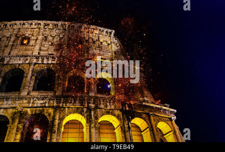 Digital manipulation of fire at the Colosseum or Coliseum at night, Rome, Italy. - Stock Image