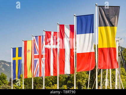 Flags of some of the Member States, including the United Kingdom, of the European Union against a blue sky - Stock Image