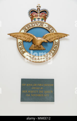 Emblem and motto 'Per Ardua ad Astra' of the RAF, with a plaque commemorating its opening by HM the Queen at the Royal Air Force Museum in Hendon. - Stock Image