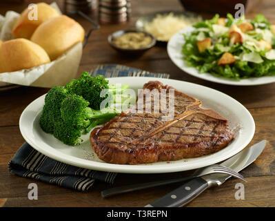 Porterhouse Steak with broccoli, salad and dinner rolls - Stock Image