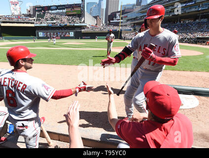 Los Angeles Angels designated hitter Shohei Ohtani celebrates with teammate David Fletcher (L) in the dugout after scoring on a sacrifice fly by Brian Goodwin #18 in the seventh inning during the Major League Baseball game against the Minnesota Twins at Target Field in Minneapolis, Minnesota, United States, May 15, 2019. Credit: AFLO/Alamy Live News - Stock Image