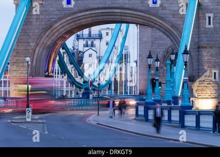 Traffic, Tower Bridge at twilight, London, England - Stock Image