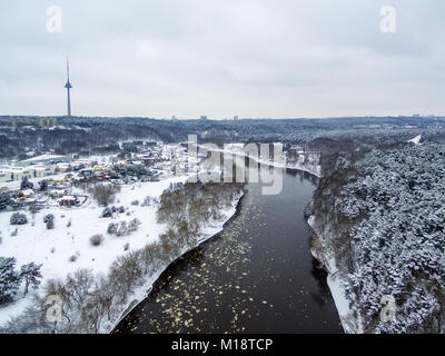 Vilnius, Lithuania: aerial top view of Neris river, Vingis park and TV tower in winter - Stock Image