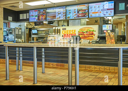 Interior service counter of a Burger King fast food restaurant in Montgomery Alabama, USA. - Stock Image