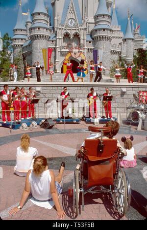 Orlando Florida Disney World Magic Kingdom Cinderella Castle hourly show wheelchair visitor - Stock Image