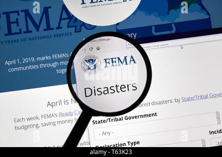 MONTREAL, CANADA - APRIL 24, 2019 : Fema.gov Disasters USA Government home page under magnifying glass. FEMA is The Federal Emergency Management Agenc - Stock Image